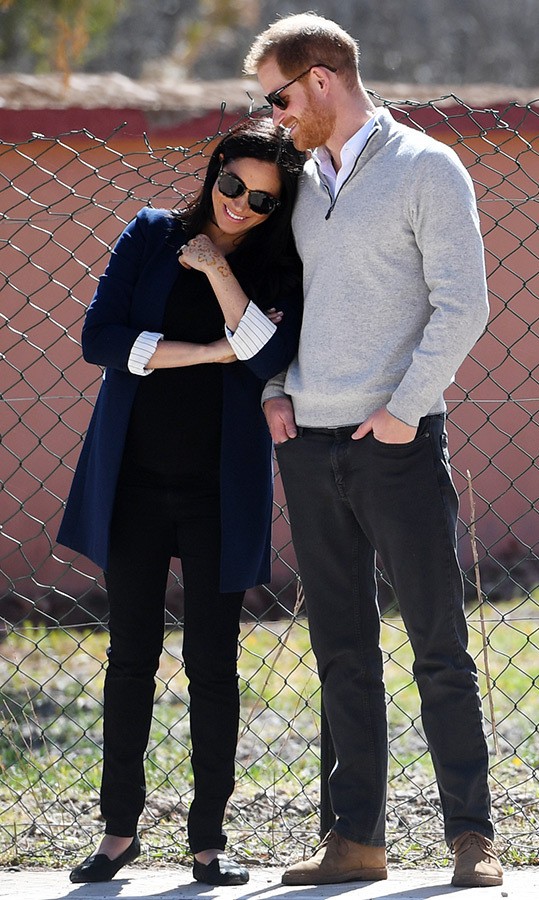 Meghan and Harry made the sweetest couple while watching students play football during their visit to Lycée Qualifiant Grand Atlas on Feb. 24. The duchess – who's expecting their first child in the spring – adorably leaned into her husband.