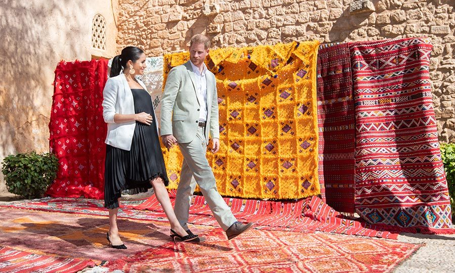 It was certainly a colourful visit for the couple, who crossed over a beautiful rug to be greeted by well-wishers.
