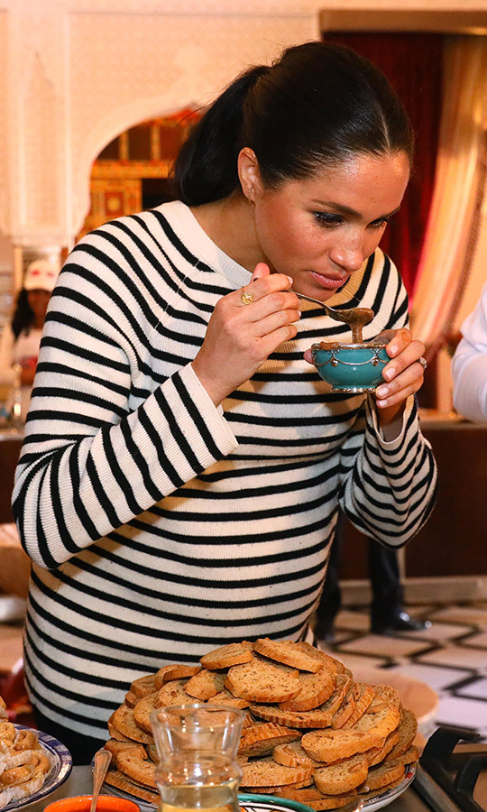 The Duchess of Sussex tried some food during the demonstration. A known foodie, Meghan helped release a cookbook last year called <em>Together: Our Community Cookbook</em>.