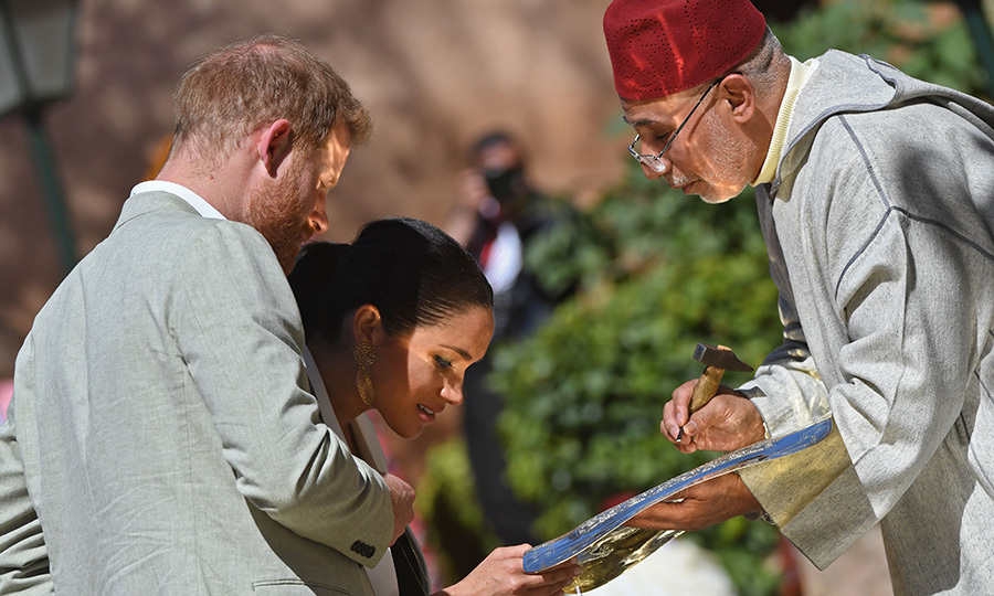 Prince Harry and Meghan met with a metal engraver during their visit to the Kasbah of the Udayas near the Moroccan capital Rabat.
