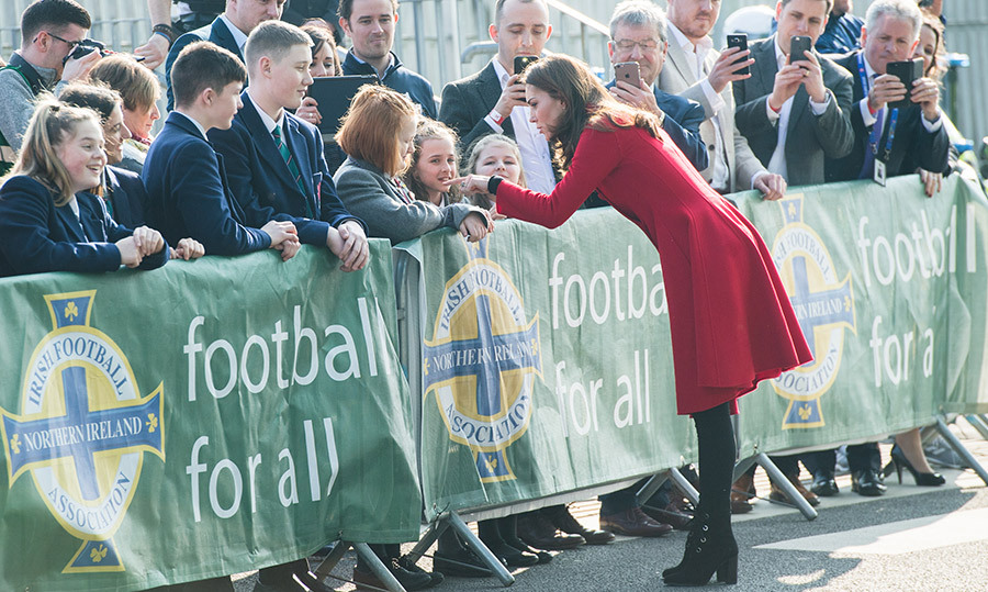 The mother of three chatted with some youngsters at the stadium.