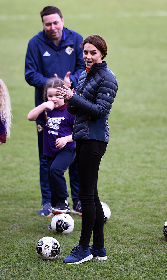 After a quick outfit change into a pair of sneakers and a puffer jacket, Duchess Kate took part in a cross community IFA demonstration at Windsor Park.