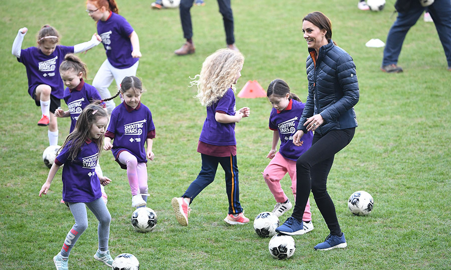 A lucky gaggle of kids got to kick around a soccer ball with the Duchess of Sussex!