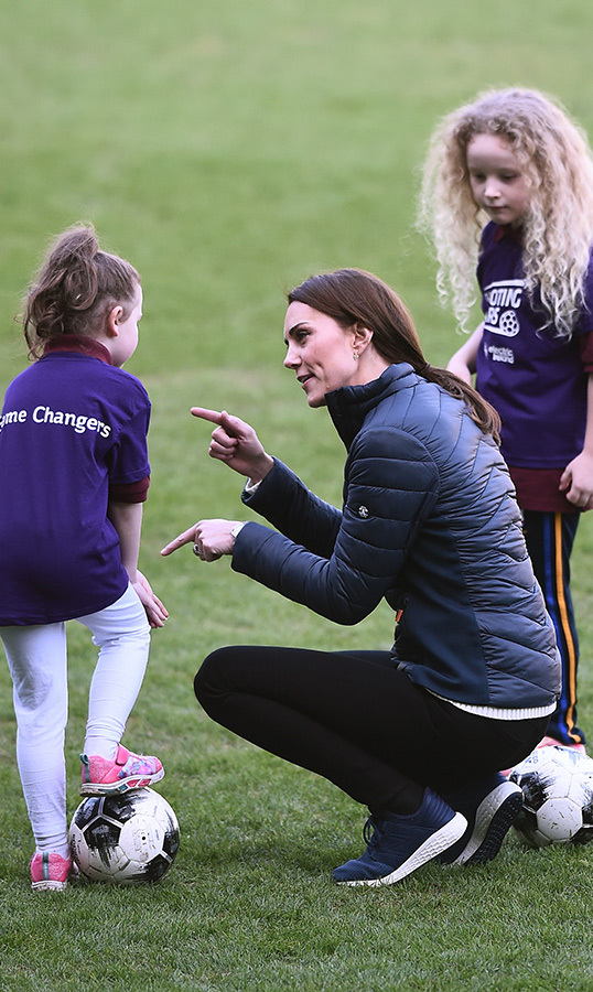 She showed off her natural charm with children, squatting down to help explain a move to a child.