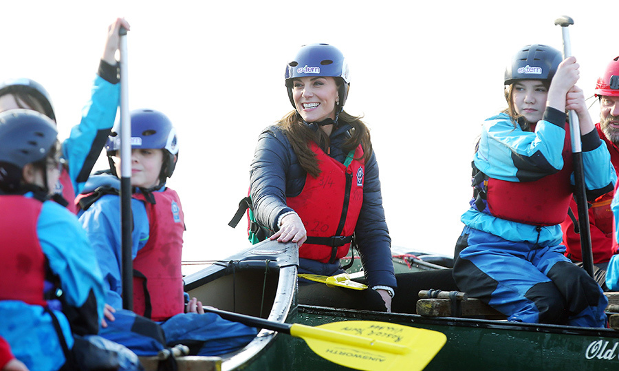 Duchess Kate strapped on her helmet and headed out on canoes with some kids at the Roscor Youth Village later in the day.