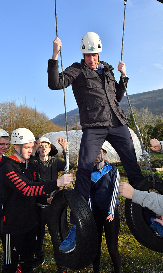 Prince William had some fun with a group of kids on an obstacle course.
