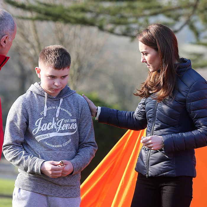 Duchess Kate showed off her soft side by comforting a young boy during a tent building exercise.