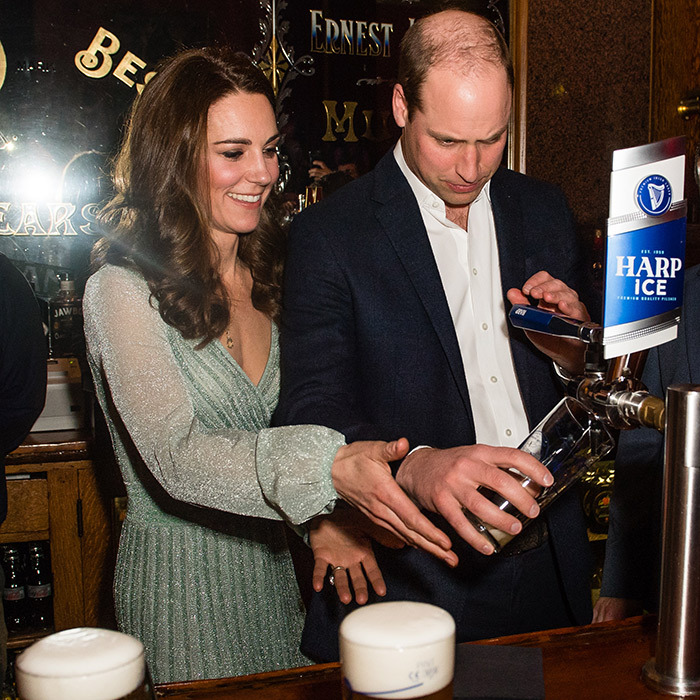 The duchess helped her husband pull a pint of Harp Ice.