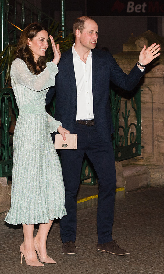 The couple waved at well-wishers as they left the music hall.