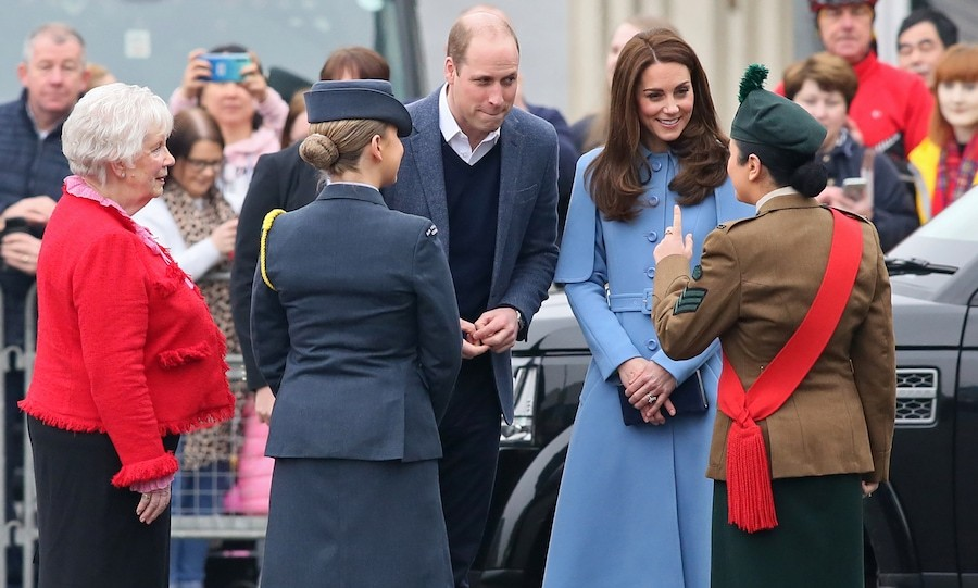 Prince William and Kate were greeted by officials at the town square.