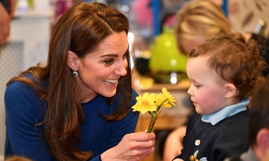 Too sweet! Kate received a bunch of daffodils from a child during the visit. Kids sure do know the way to the duchess's heart.