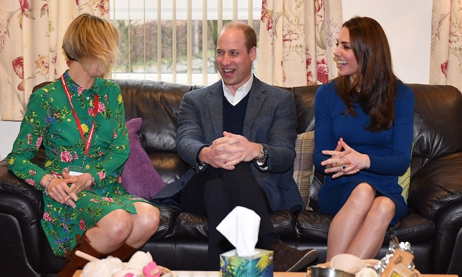 Prince William and Kate spoke with helpers during a visit to St Josephs Sure Start Facility in Ballymena, north of Belfast in Northern Ireland.