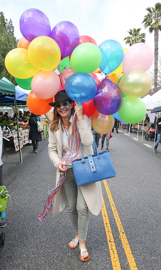 Allison Janney carried a bundle of balloons while out and about in Los Angeles on March 3.