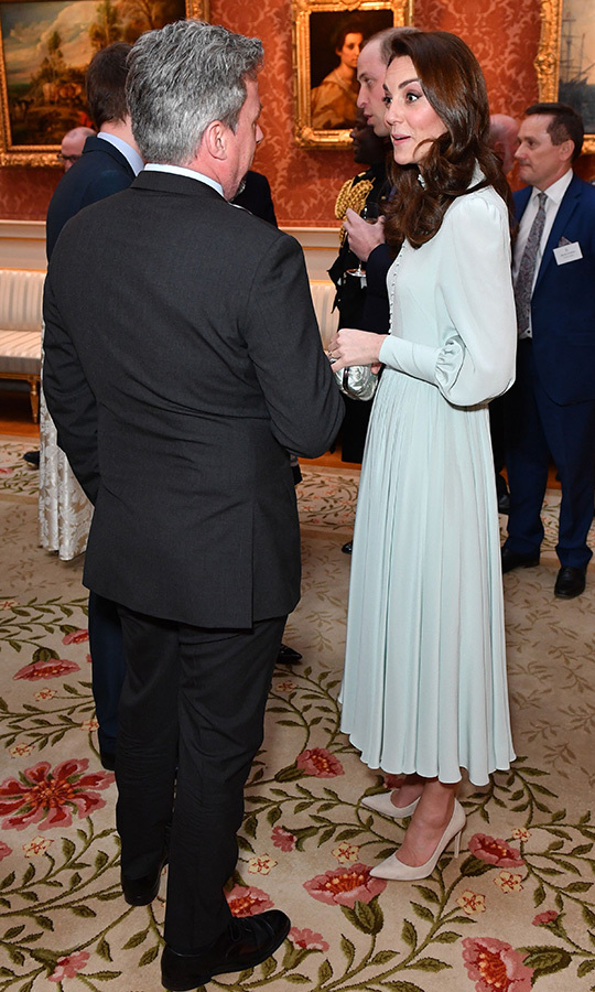Kate chatted with a guest during the reception.