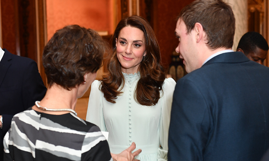 Kate chatted with guests at the reception. Her beauty look was absolutely perfect for the day, with her natural beauty shining through a swipe of coral blush and a subtle pink lip.