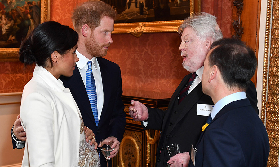 Prince Harry and Meghan spoke with British army veteran and charity campaigner Simon Weston and Britain's Wales Secretary Alun Cairns during during the event.