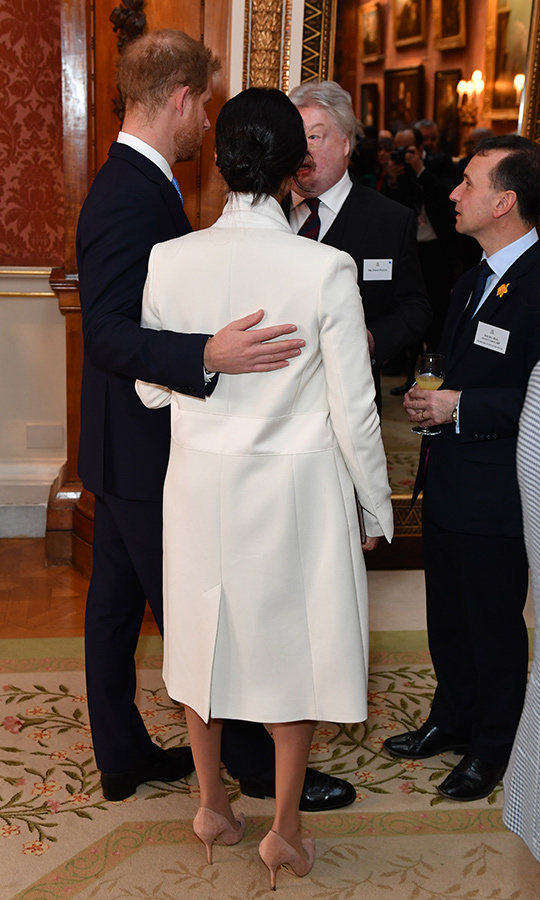 While talking with the two, Prince Harry lovingly put his arm around his pregnant wife. They must be overjoyed to be welcoming Baby Sussex so soon!