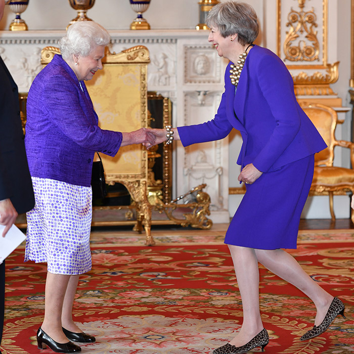 Queen Elizabeth welcomed British Prime Minister Theresa May to the reception. They both dazzled in purple!