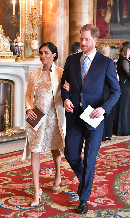 "<strong><a href=""https://ca.hellomagazine.com/tags/0/meghan-markle"">Duchess Meghan</a></strong> – who's due to welcome her first child with <strong><a href=""https://ca.hellomagazine.com/tags/0/prince-harry"">Prince Harry</a></strong> in the spring – kept her royal baby bump warm in her white ""Crombie"" coat by Amanda Wakeley (the one she wore for last year's Commonwealth Day.) She carried her ""Oyster"" satin clutch by Wilbur and Gussie, and accessorized with a beautiful pair of bar earrings by Canadian jeweller Birks, as well as her Pippa Small ""Wajiha"" cuff. Anchoring the ensemble were her ""Pump It Up"" shoes by Paul Andrew. Though the dress designer is yet unknown, the subtle metallic hues perfectly complement her glowing complexion.
