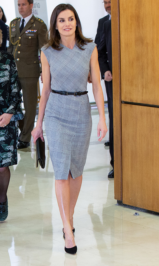 "<strong><a href=""https://ca.hellomagazine.com/tags/0/queen-letizia"">Queen Letizia</strong></a> of Spain dazzled in a fitted, checked dress while attending the Rare Diseases World Day event at Duques de Pastrana Palace on March 5. She accessorized with a slim black belt, a black clutch and beautiful matching pumps.
