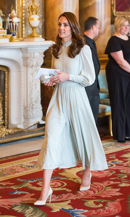 To celebrate the 50th anniversary of Prince Charles's investiture as the Prince of Wales, Kate stunned in a mint-green gown by the designer, which boasted a stunning high neck and a billowing skirt.