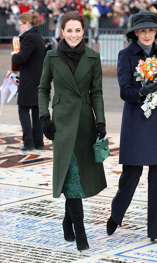 "The <strong><a href=""https://ca.hellomagazine.com/tags/0/prince-william"">Duke</a></strong> and <strong><a href=""https://ca.hellomagazine.com/tags/0/kate-middleton"">Duchess of Cambridge</a></strong> visited Blackpool on March 6. Kate brought some colour to an otherwise gloomy day in a chic green coat by Spartmax. Underneath the elegant piece, Kate wore a Michael Kors Peacock Pattern dress, accessorizing the look with a small bag by Manu Atelier, a pair of black gloves, a green scarf and a beautiful pair of calf-length black suede stiletto boots, which appear to be by Ralph Lauren.