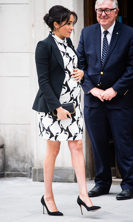 The 37-year-old wowed in a sweet mod mini dress from affordable British brand REISS. She paired the black-and-white number with a blazer by Alexander McQueen (one of Duchess Kate's favourite designers!), anchoring the look with her black suede Manolo Blahnik BB pumps and her favourite Stella McCartney clutch – the Shaggy Deer Faux Leather Crossbody. Of particular note was Meghan's brooch, fixed with the symbol for the Queen's Commonwealth Trust.