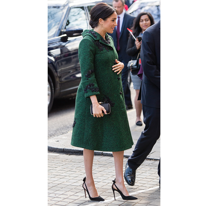 For Commonwealth Day on March 11, Duchess Meghan beautifully wrapped her baby bump in a deep green off-the-runway coat by the Turkish-Canadian designer. Fixed with black floral appliqué, the stunning piece was matched by an equally gorgeous matching knee-length dress underneath. The pregnant royal – who's expecting her first child around the end of April – accessorized with her Givenchy satin clutch, Birks opal earrings and a dangling bracelet by Turkish jewelry brand Kismet by Milka. Anchoring her look was her favourite pair of Aquazzura Deneuve pumps, which she also owns in a pretty blush pink colour.