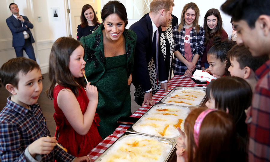 Duchess Meghan and Prince Harry were al smiles as they joined a group of children to make maple taffy at Canada House. The treat is made by setting hot maple syrup on snow to cool and is a favourite with Canadian kids! As you can see, it proved a hit during their visit, too!