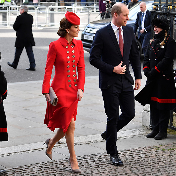 The Duke and Duchess of Cambridge were the first of the Fab Four to arrive at Westminster Abbey. Kate dazzled in a bright red Catherine Walker military style coat, pairing it with a matching cap, a grey clutch and grey suede pumps. Prince William looked dapper in a navy suit, matching his red tie to his wife's ensemble.