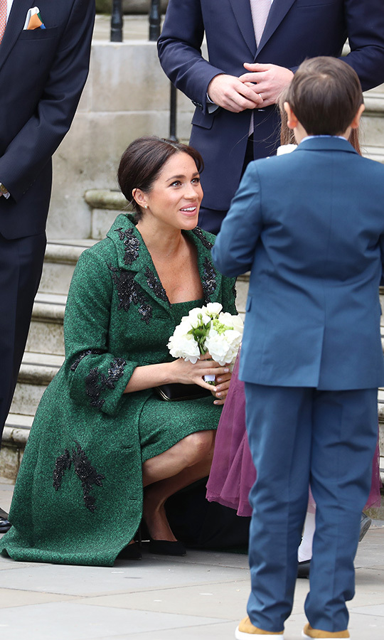 Duchess Meghan is about eight months pregnant with her first child with Prince Harry, and was very keen to meet and greet children at the event. 