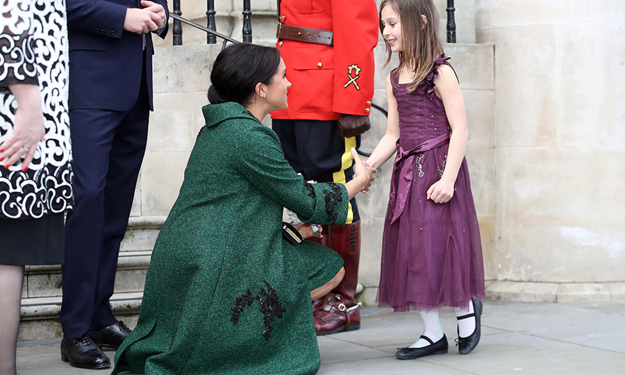 The mom-to-be accepted bouquets from children outside Canada House, which is the Canadian consulate in London, before the event began. She was very engaged, getting down on her knees at eye level with the kids to say a special hello!