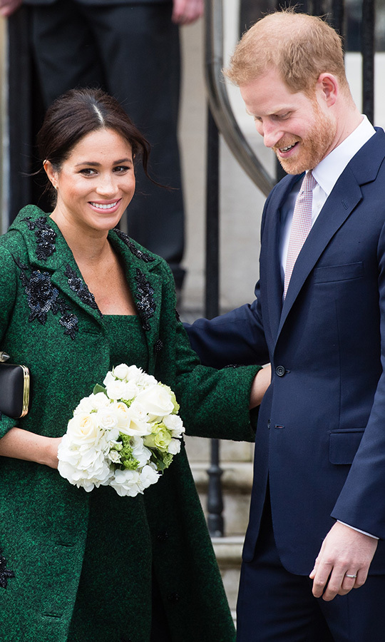 Duchess Meghan and Prince Harry were all smiles at the event, beaming and looking positively in love as they accepted presents from their greeters and headed in to Canada House.