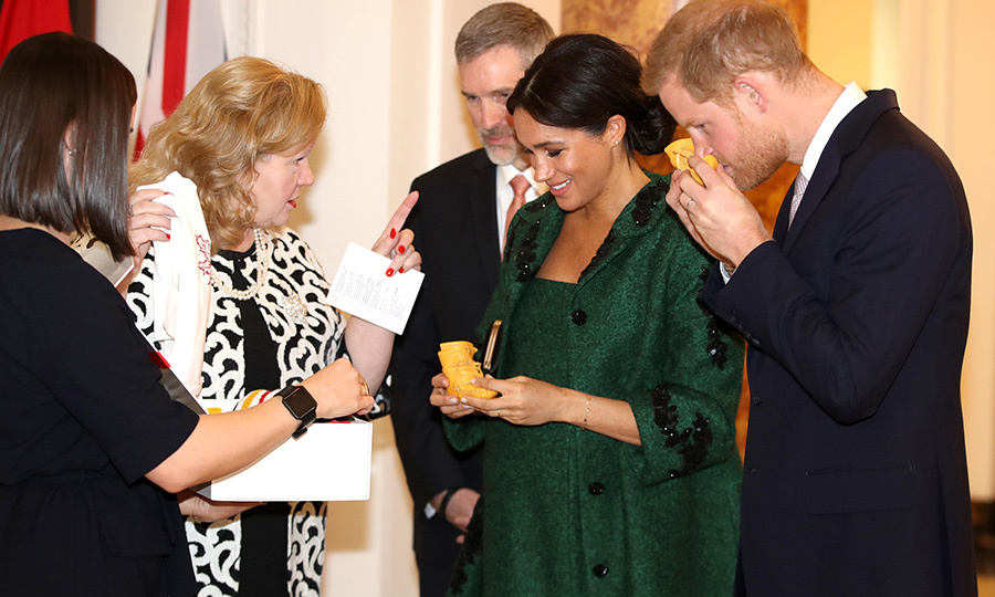 Prince Harry took the time to sniff one of the moccasins presented to him by Canadian High Commissioner to the United Kingdom Janice Charette. Aww! 