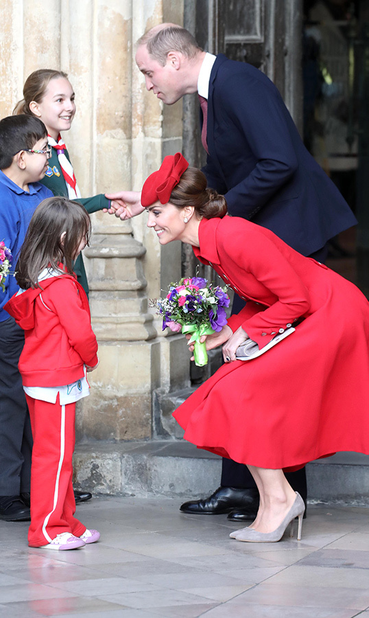 As they were leaving, Prince William and Kate stopped to chat to some adorable little ones. As always, Kate crouched low to receive a beautiful bouquet from a young girl.