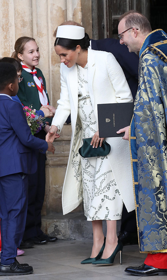 Duchess Meghan and Prince Harry always greeted the young ones standing outside of the Abbey.