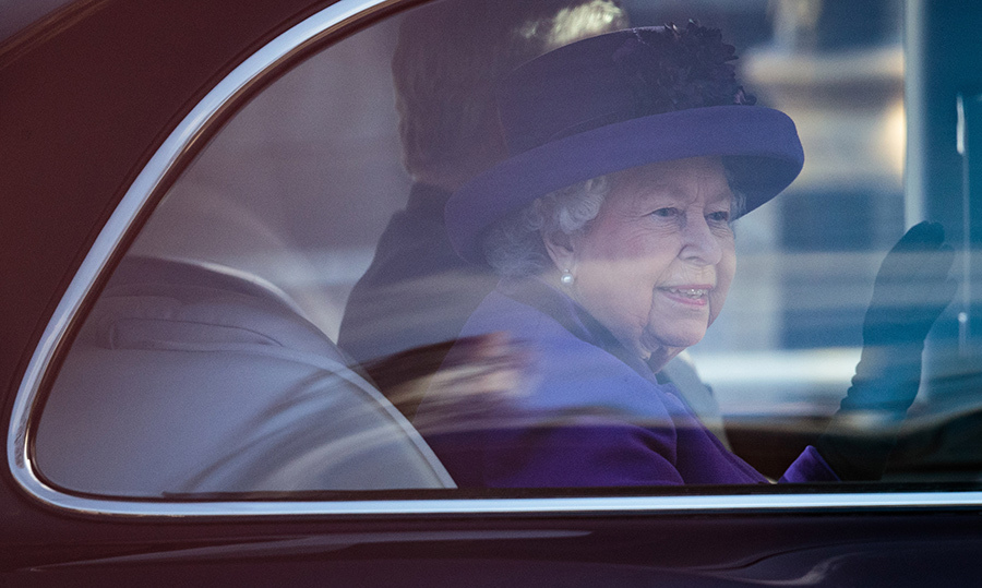 The Queen smiled happily while waving at her well-wishers as she drove away from Westminster.