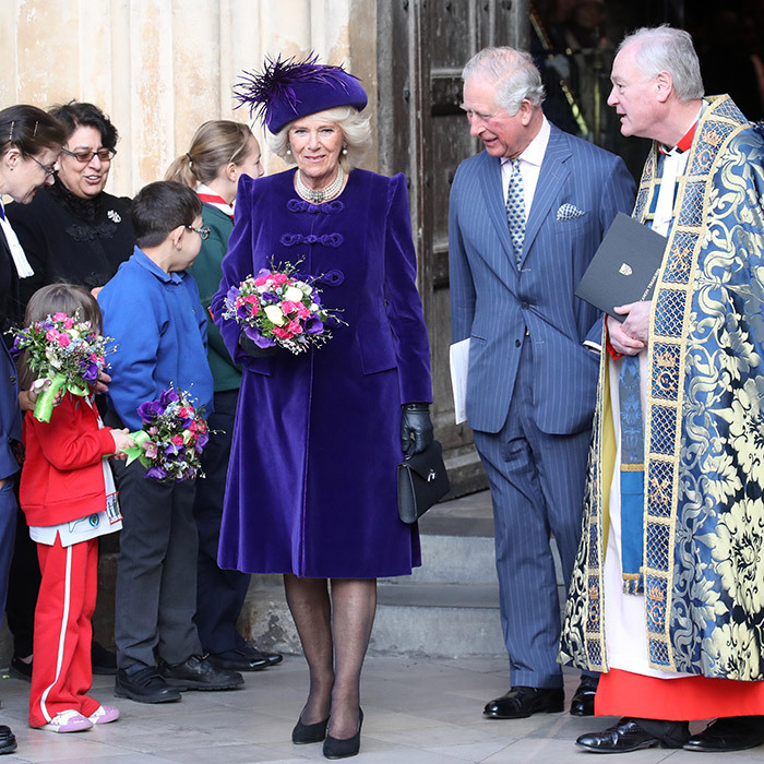 The Duchess of Cornwall looked lovely as ever in purple – and her new flower bouquet perfectly matched her ensemble!
