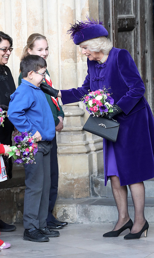 Camilla patted a young boy on the shoulder, who looked thrilled to be meeting her.