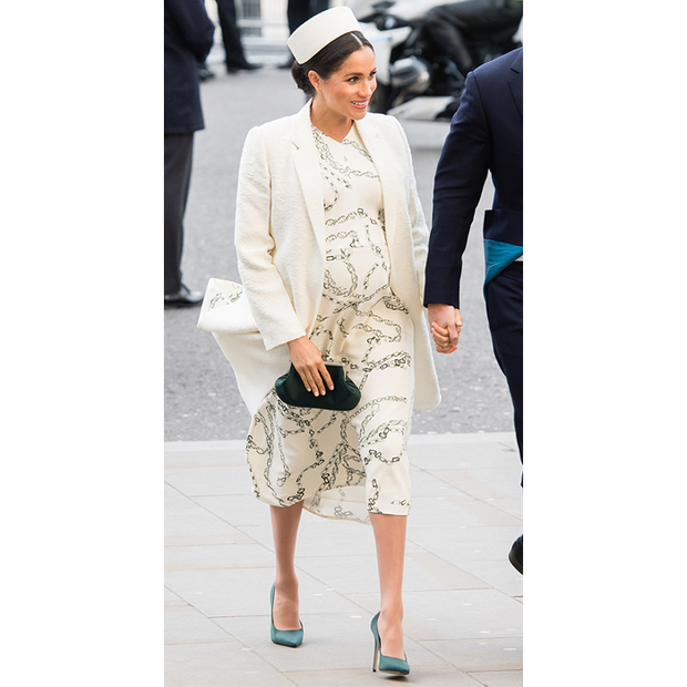 A quick outfit change later and the Duchess of Sussex was out again for the <strong><a href=/tags/0/commonwealth-day>Commonwealth Day</a></strong> service! The pregnant duchess wowed in a print midi dress by one of her go-to British designers, <strong><a href=/tags/0/victoria-beckham>Victoria Beckham</a></strong>. She paired the look with a cream coat, anchoring the ensemble with a pair of dark green satin pumps. 