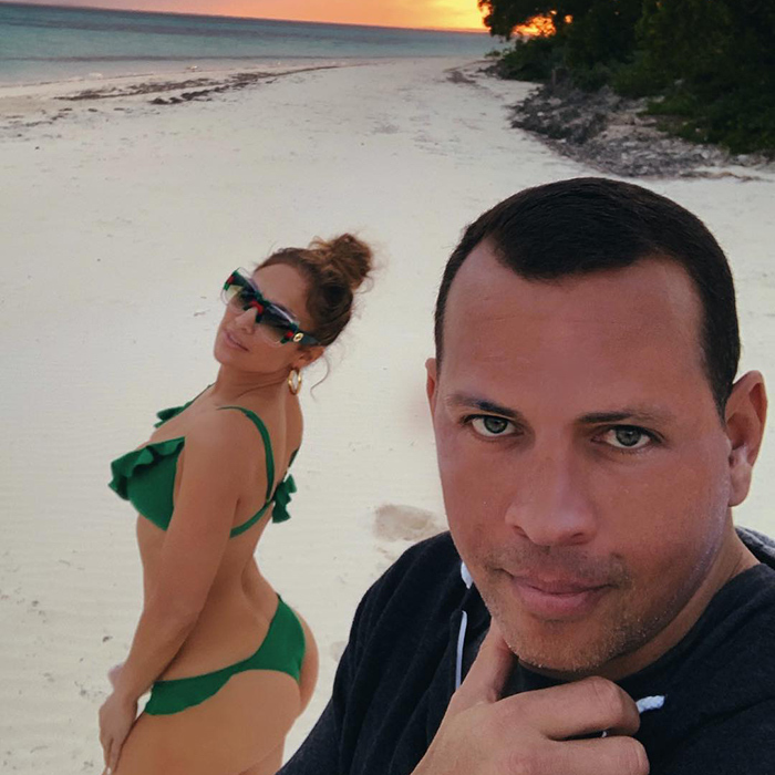 "These two really know how to vacation! During a stunning sunset on their private beach in the Bahamas, A-Rod made sure to get a snap. J. Lo looked amazing as ever in a green bikini. ""#beachbums ,"" the 49-year-old captioned it.
