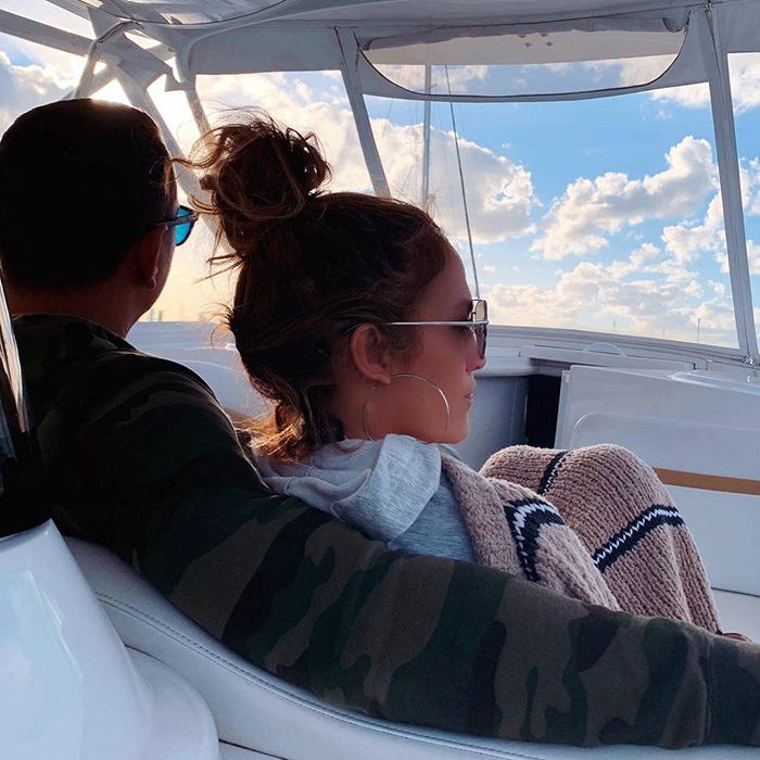 The couple took to their boat for a day of sea, sun and relaxation! The mother-to-two kept warm with a grey hoodie and blanket... And the loving embrace of her fiancé, Alex.