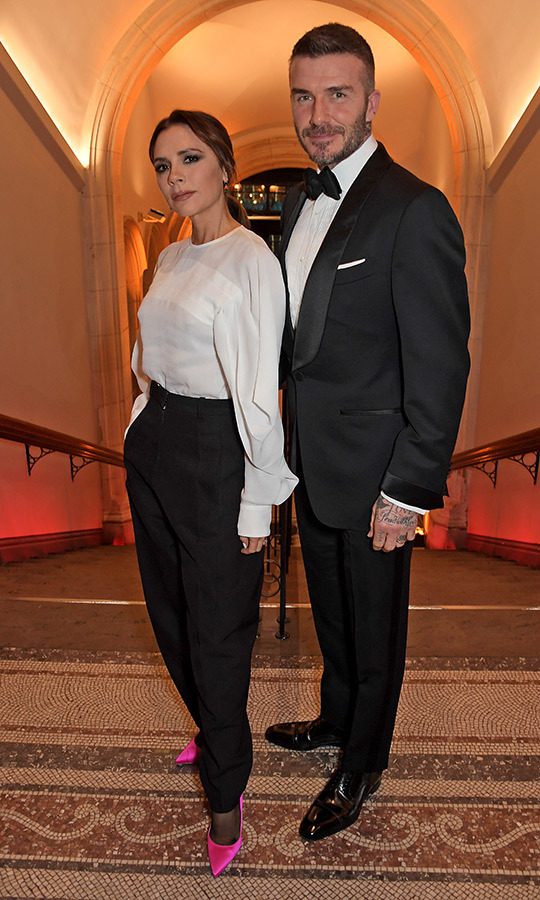 The Beckhams posed for a quick snap inside the gallery, showing off the equally cool outfits.