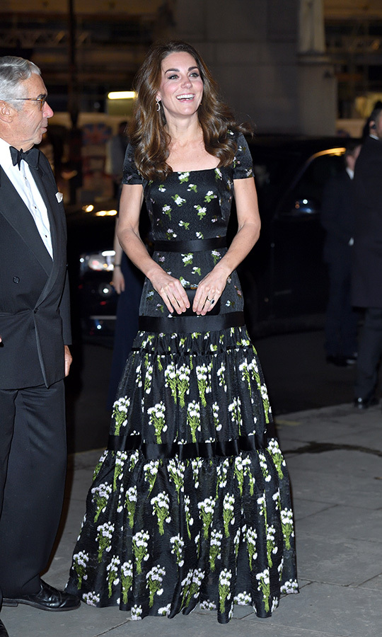The Duchess of Cambridge turned heads in a recycled (and revamped!) Alexander McQueen gown – the same one she wore at the 2017 BAFTAs. Opting for a short sleeve instead of the original off-the-shoulder look, she accessorized the outfit with pink morganite and diamond earrings by Kiki McDonough and a black Prada clutch.