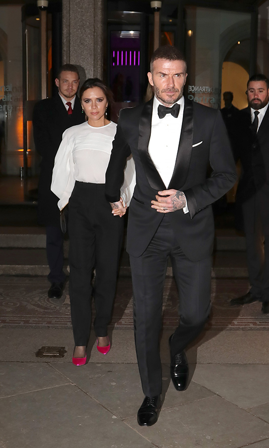 David and Victoria Beckham clasped hands as they left the National Portrait Gallery.