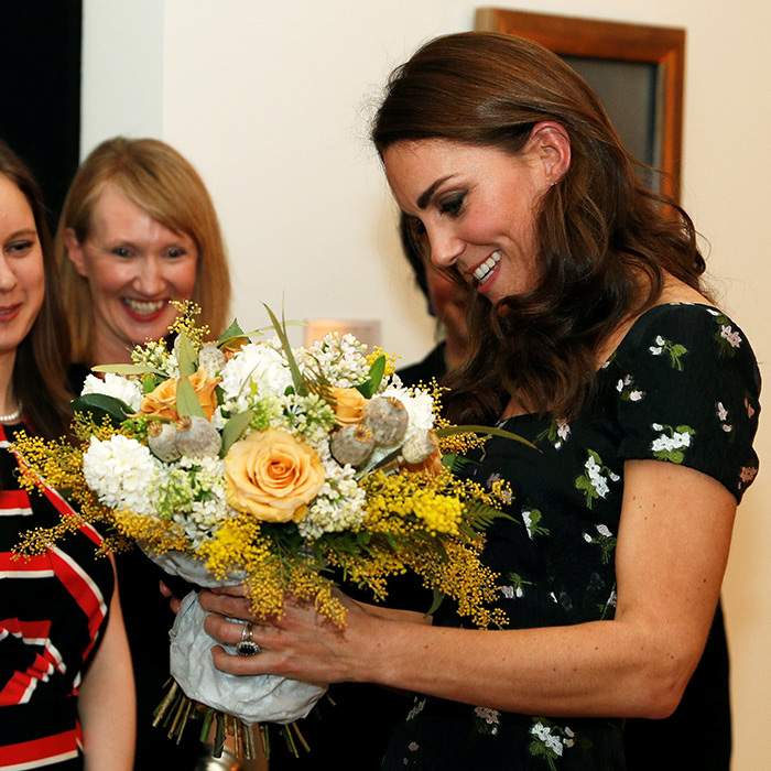 The duchess received some flowers at the gala.