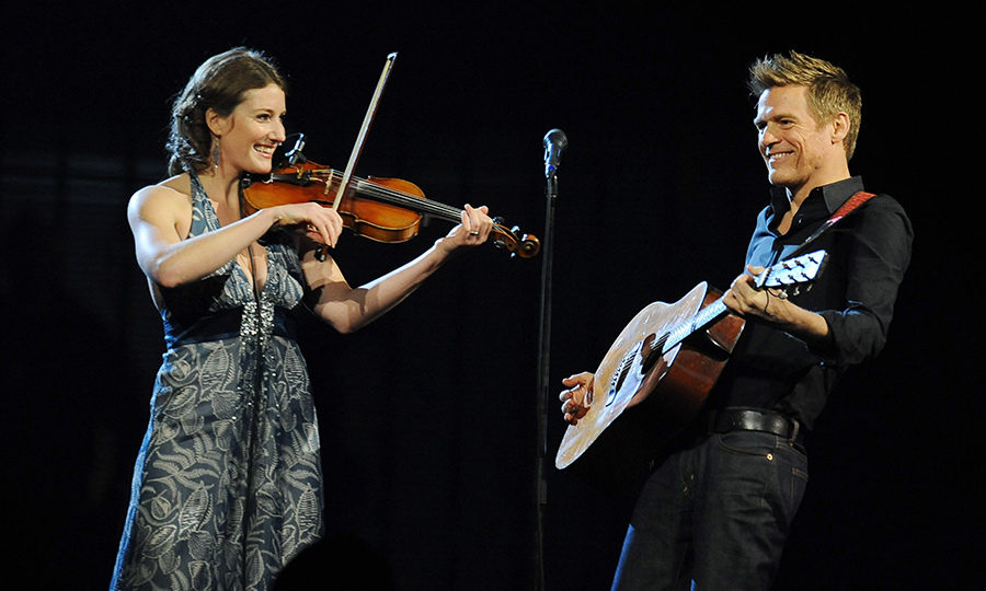 Kathleen Edwards, on violin, and Bryan Adams showed off their megawatt smiles while putting on an energetic performance.