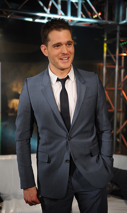 "Canadian crooner Michael Bublé showed off his charismatic smile backstage in the E Talk Lounge. The family man looked dapper as ever in a blue suit. The now-father-to-three was up for Single of the Year for his song ""Lost.""