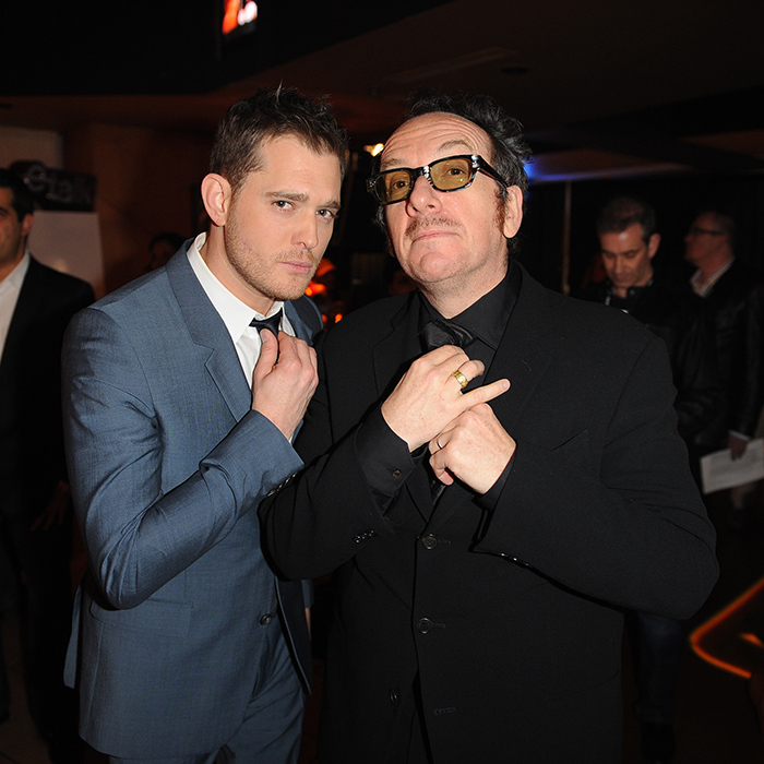 Snazzy! Michael Bublé and Elvis Costello looked extra dapper fixing their ties in the E Talk Lounge.