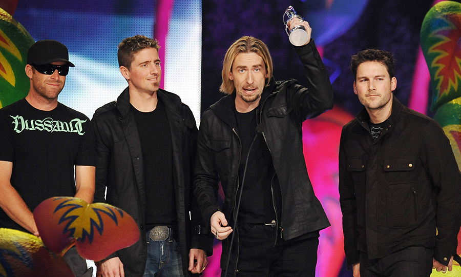 "Nickelback for the win! The celebrated Canadian band took home Album of the Year for their <em>Dark Horse</em> LP, which features well-known tracks like ""Gotta Be Somebody"" and ""Something In Your Mouth.""